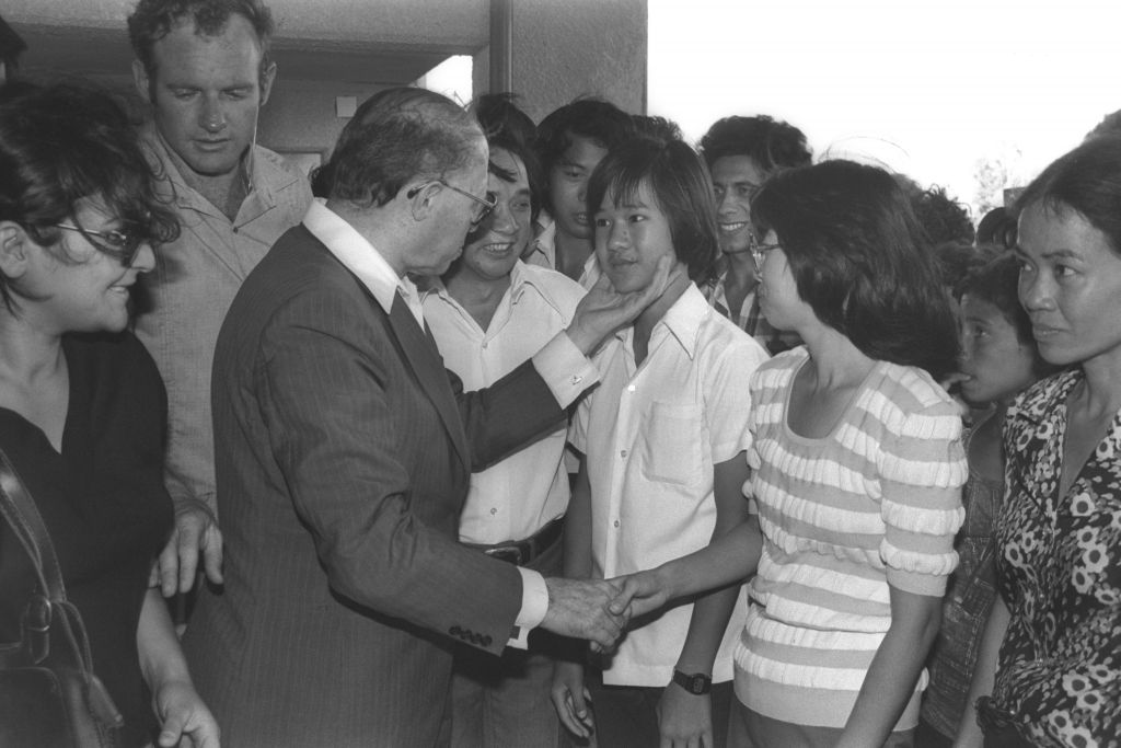 Prime Minister Menachem Begin greets Vietnamese refugees who were absorbed in Afula, June 26, 1980 Photo credit: Herman Chanania/GPO)