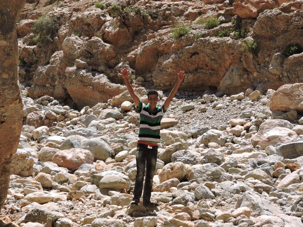 JTA reporter Ben Sales' 'fixer,' Mohammed, experiencing a moment of triumph along the etrog trail. (Ben Sales/JTA)