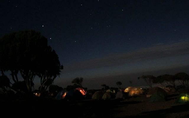 Camping under a full moon and a sky filled with stars. (Melanie Lidman/Times of Israel)