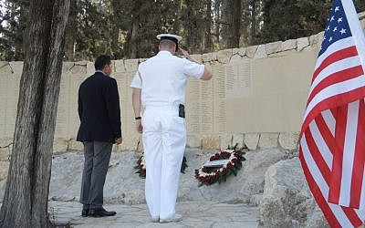 Representatives from the Canadian Embassy (left) and the American Embassy lay a memorial wreath at the AACI memorial forest outside Jerusalem on Sunday, September 20, 2015. (Melanie LIdman/Times of Israel)