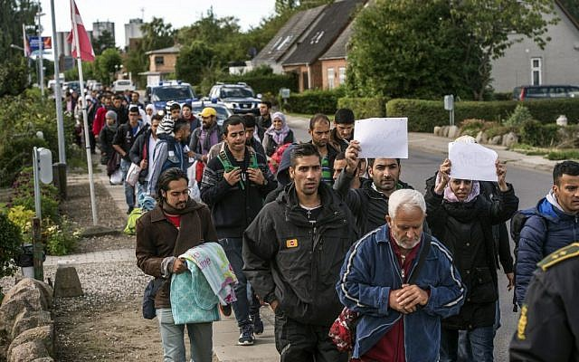 Illustrative: Middle Eastern migrants, who came from Germany by ferry and train Sunday night, and are walking from Rodby in southern Denmark towards Sweden on Monday Sept. 7, 2015. (AP/POLFOTO, Per Rasmussen)