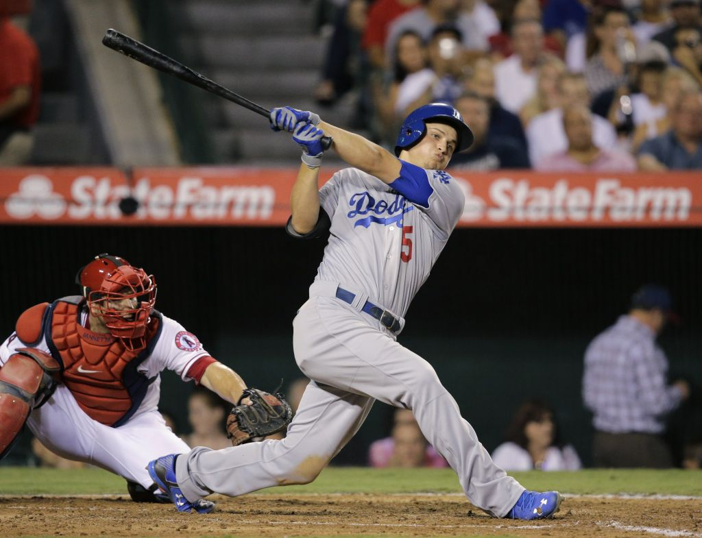 Los Angeles Dodgers' Corey Seager follows through on an RBI double during the sixth inning of a baseball game against the Los Angeles Angels, Tuesday, September 8, 2015, in Anaheim, Calif. (AP Photo/Jae C. Hong)