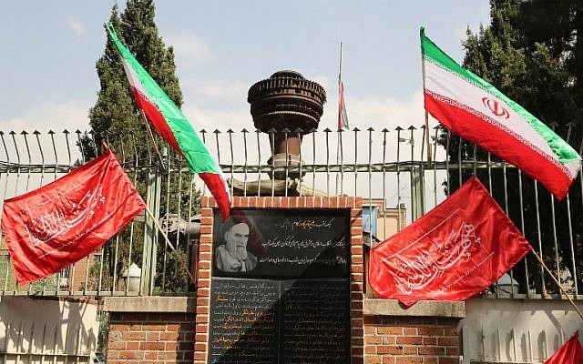 Iranian flags flutter above religious banners during the inauguration of an anti-American plaque displayed outside the former American embassy in Tehran on September 2, 2015. (Atta Kenare /AFP)