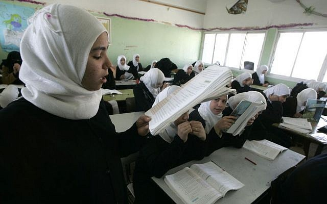 Female students in a classroom in Rafah, southern Gaza Strip, March 2009 [Abed Abed/Flash90]