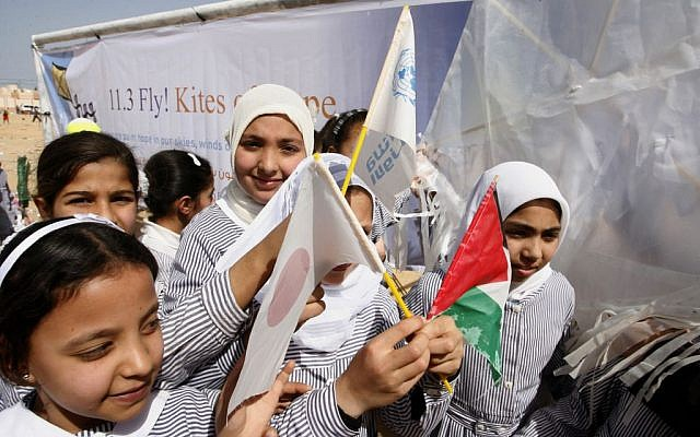 Palestinian school girls holds the flags of Palestine and the flag of Japan to show their solidarity with Japan in Khan Younis, southern Gaza Strip, March 11, 2013 (Abed Rahim Khatib/Flash90)