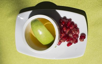 Apple in honey and pomegranate, traditionally eaten during Rosh Hashanah (Noam Revkin Fenton/ Flash90)