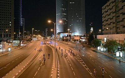 Israelis ride their bicycles on empty roads in Tel Aviv, on Yom Kippur, the holiest of Jewish holidays. The photo was taken on October 03, 2014. (Danielle Shitrit/Flash 90)