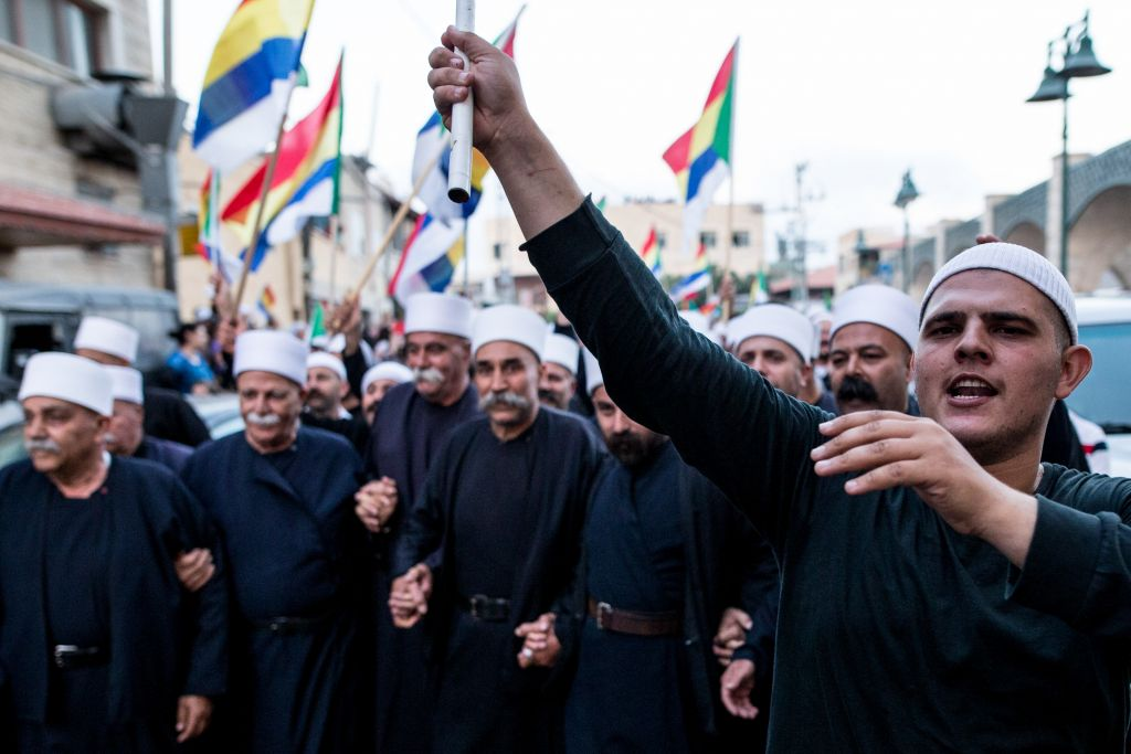 File: Israeli Druze from the village of Yarka attend a demonstration in support of their brethren in Syria threatened by fighting in that country's civil war, June 14, 2015. (Basel Awidat/Flash90)
