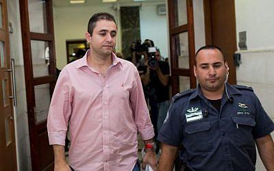 Eran Malka, left, a former top police officer caught in a corruption case, leaves the Jerusalem District Court in Jerusalem, June 15, 2015. (Yonatan Sindel/Flash90)