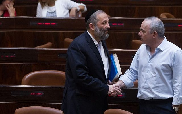 Economy Minister Aryeh Deri speaks with Energy Minister Yuval Steinitz during a plenum session in the Knesset on June 17, 2015. (Miriam Alster/FLASH90