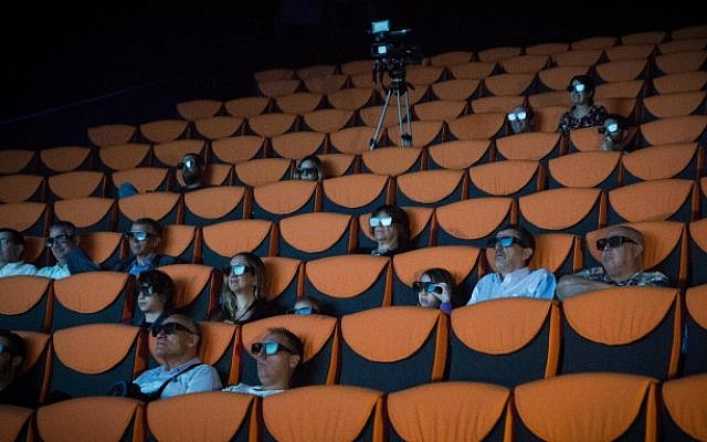 People enjoy a sample Imax screening at the new Yes Planet cinema, before opening in Jerusalem, on August 11, 2015. Yes Planet, in the mixed Arab/Jewish neighborhood of Abu Tor, is open on Shabbat. (Hadas Parush/Flash90)