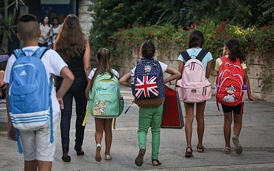 Children arrive for their first day of school at the Paula Ben Gurion school in Jerusalem on September 1, 2015. (Hadas Parush/Flash 90)