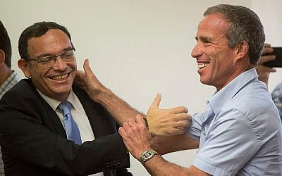 Outgoing Yesh Atid parliament member Shai Piron (L) seen with incoming Yesh Atid parliament member Elazar Stern at a Yesh Atid party meeting at the Knesset, Israel's parliament in Jerusalem on August 2, 2015. (Yonatan Sindel/Flash90)