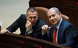 Prime Minister Benjamin Netanyahu (right) speaks with Public Security Minister Gilad Erdan (left) at the Knesset in Jerusalem on September 7, 2015. (Yonatan Sindel/ Flash90)