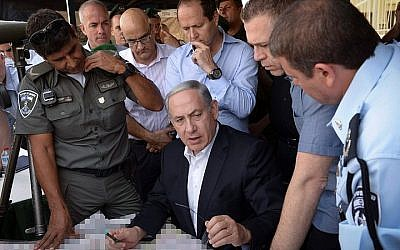 Prime Minister Benjamin Netanyahu, Minister of Public Security Gilad Erdan and Jerusalem mayor Nir Barkat tour Jerusalem following the recent clashes in Jerusalem's Old City, on September 16, 2015. (Amos Ben Gershom/GPO)