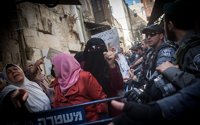 Palestinian Muslim women from the Murabitun group shout slogans and hold the Koran during a protest against Israel policemen preventing them from entering al-Aqsa Mosque compound in Jerusalem's Old City on September 17, 2015. (Miriam Alster/Flash90 )