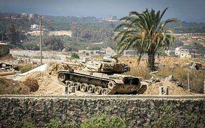 An Egyptian tank is seen from the border of southern Gaza Strip with Egypt September 18, 2015. According to Palestinian witnesses, Egyptian forces pumped water from the Mediterranean Sea through pipes to destroy smuggling tunnels dug beneath the Gaza-Egypt border. (Photo by Abed Rahim Khatib/Flash90)