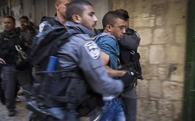 Israeli police arrest a young Palestinian during a protest in Jerusalem's Old City on September 22, 2015. (Hadas Parush/Flash90)