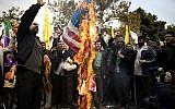 Iranian protesters burn an American flag during an annual anti-American rally in Tehran, Iran, Monday, Nov. 4, 2013.  (Ebrahim Noroozi/AP)