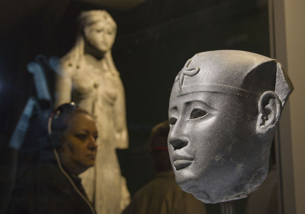 The head of a Pharaoh, 26th dynasty at the Arab World Institute, part of the Osiris, Sunken Mysteries of Egypt exhibition in Paris, France, Wednesday, September 9, 2015. (Michel Euler/AP)