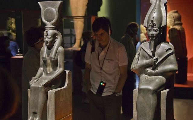 "Statues of Isis, left and Osiris (570-526 BC), displayed at the Arab World Institute, part of the ""Osiris, Egypt's Sunken Mysteries"" exhibition in Paris, France, Wednesday, September 9, 2015. (Michel Euler/AP)"