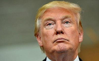 Republican presidential candidate Donald Trump listens during a news conference after speaking at the TD Convention Center in Greenville, South Carolina, August 27, 2015  (AP Photo/Richard Shiro)
