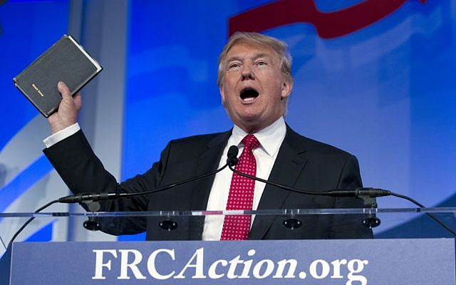 Republican presidential candidate, businessman Donald Trump, holds up a Bible given to him by his mother as he speaks during the Values Voter Summit, held by the Family Research Council Action, Friday, Sept. 25, 2015, in Washington (AP Photo/Jose Luis Magana)