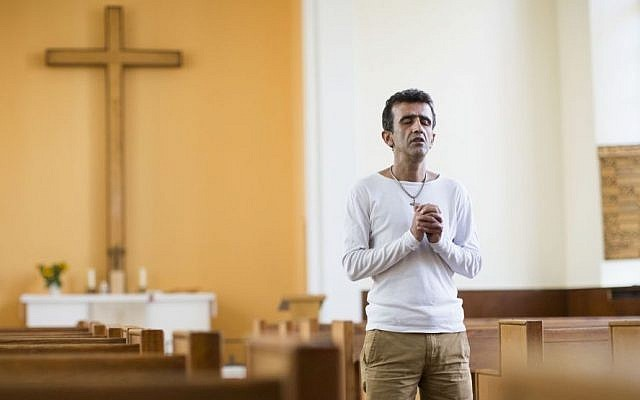 Iranian asylum-seeker Aref Movasaq Rodsari stands in the Trinity Church in Berlin, Germany, Aug. 13, 2015. (AP/Gero Breloer)