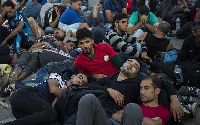 Migrants and refugees wait to be registered by police at the port of Mytilene, on the Greek island of Lesbos, September 6, 2015. (AP/Santi Palacios)