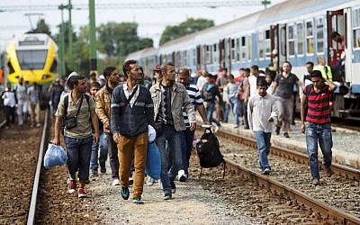 Migrants and refugees arrive at the railway station in Szentgotthard, 246 kilometers southwest of Budapest, Hungary, near the Austrian border, Saturday, Sept. 19, 2015. (Gyorgy Varga/MTI via AP)
