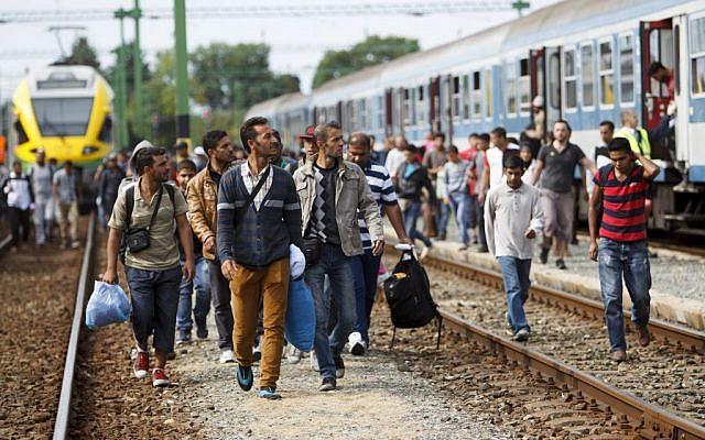 Migrants and refugees arrive at the railway station in Szentgotthard, 246 kilometers southwest of Budapest, Hungary, near the Austrian border, Saturday, September 19, 2015. (Gyorgy Varga/MTI via AP)