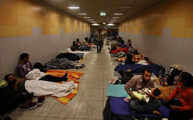 Asylum seekers sleep at Keleti underground railway station in Budapest, Hungary, Sept. 4, 2015. (AP/Frank Augstein)
