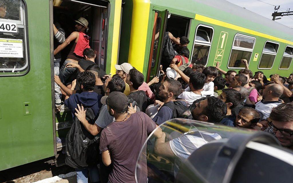 Migrants get back on a train in Bicske, Hungary, Thursday, Sept. 3, 2015. (AP/Petr David Josek)