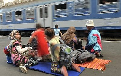 Migrants wait to board the train that will take them towards Munich, Germany at the Keleti Railway Station in Budapest, Hungary, Monday, Aug. 31, 2015 (Tamas Kovacs/MTI via AP)