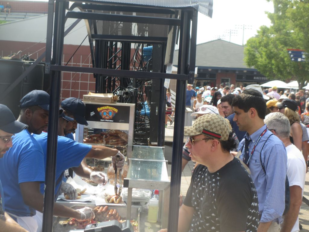 Avid, yet hungry, tennis fans at the US Open underway in Flushing Meadows stop at Jonathan Katz's Kosher Grill behind court 17. (Howard Blas/The Times of Israel)