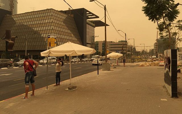 Illustrative: Heavy dust turns the Tel Aviv sky orange at midday on September 8, 2015, in the worst sandstorm yet recorded in the country. (Times of Israel)