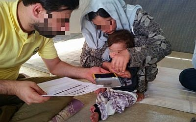 CYCI mediator documents the release of a Yazidi woman and her child. (courtesy)