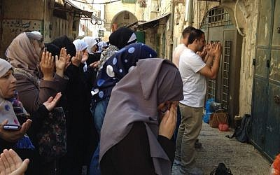 Female Muslim activists, known as Murabitat, pray outside Temple Mount to protest a government decision banning them from the site during visiting hours, September 2, 2015 (Elhanan Miller/Times of Israel)