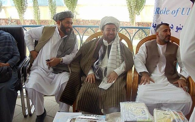 Antepli Antepli, in traditional Afghan clothes, addresses a group of religious scholars in Wardak, Afghanistan in 2010 (Courtesy)