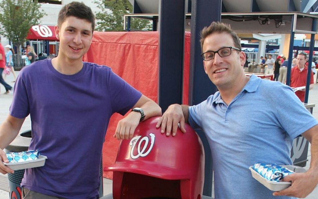 Jewish educator Yoni Kaiser-Blueth, right, with incoming George Washington University freshman Yonah Bromberg Gaber at a recent Washington Nationals game, said that Sandy Koufax's Yom Kippur decision 'resonates especially today.' (Hillel Kuttler/JTA)