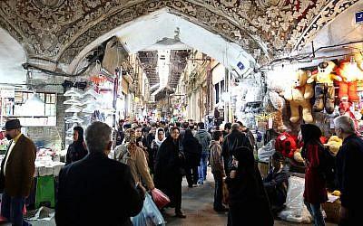 Illustrative: Iranians walking through Tehran's old main bazaar, March 18, 2014. (JTA/Ebrahim Noroozi/AP Images)
