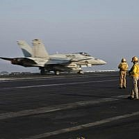 A US Marine fighter jet aircraft aboard the USS Theodore Roosevelt aircraft carrier, which serves as a base for air strikes in Syria, September 10, 2015. (AP Photo/Marko Drobnjakovic)