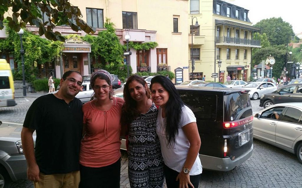 Left to right, Liad Shemesh, an Israeli tourist, outside the Great Synagogue of Tbilisi with his wife, Einat, Adi Amram and Ortal Panehla on August 20, 2015. (Cnaan Liphshiz/JTA)