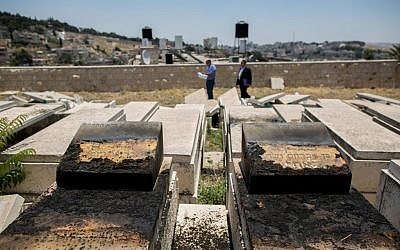 A view of the desecrated tombstones that were vandalized in the Mount of Olives cemetery in East Jerusalem on June 23, 2015. (Yonatan Sindel/Flash90)