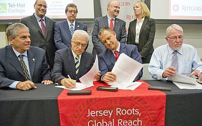 MK Erel Margalit, (R)  and Rutgers Food Innovation Center Director Lou Cooperhouse at the signing ceremony at Rutgers University in New Brunswick, New Jersey, Friday, September 18, 2015.  (Ron Sachs)