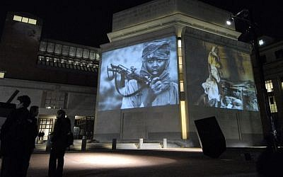 Images from Darfur and Chad are projected on the exterior walls of the United States Holocaust Memorial Museum in Washington, DC. (AP/Nick Wass)