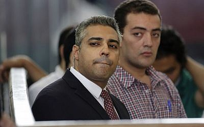 In this Thursday, June 4, 2015 file photo, Canadian Al-Jazeera English journalist Mohamed Fahmy, left, and his Egyptian colleague Baher Mohammed listen in a courtroom in Tora prison in Cairo, Egypt. (AP/Amr Nabil)