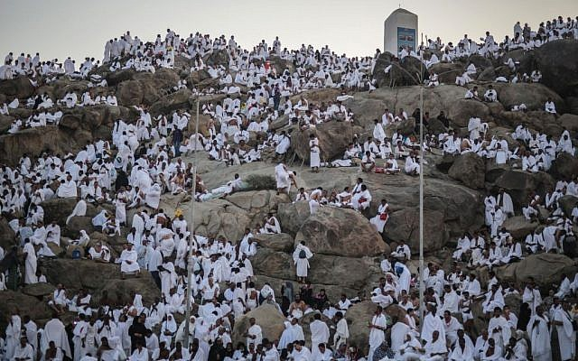 Muslim pilgrims pray on a rocky hill called the Mountain of Mercy, on the Plain of Arafat, near the holy city of Mecca, Saudi Arabia, Wednesday, September 23, 2015 during the hajj pilgrimage. (AP/Mosa'ab Elshamy)