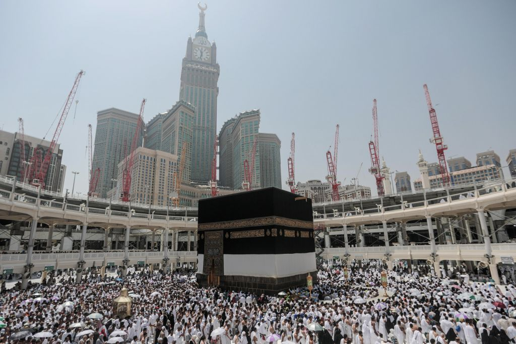 """Muslim pilgrims circle the Kaaba, the cubic building at the Grand Mosque in the Muslim holy city of Mecca, Saudi Arabia, Tuesday, Sept. 22, 2015. In Mecca, the holy site all the world's Muslims pray toward, the annual hajj pilgrimage began Tuesday with over 2 million faithful gathering to call out in Arabic: """"Here I am, God, answering your call. Here I am."""" (AP Photo/Mosa'ab Elshamy)"""