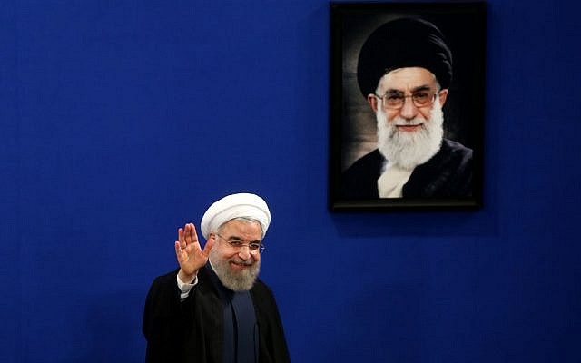Iran's President Hassan Rouhani waves to reporters at the conclusion of a press conference in Tehran, Iran, August 29, 2015. (AP/Ebrahim Noroozi)